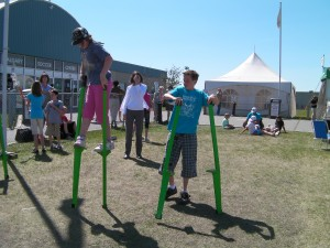 Outdoor shot of children stilt walking